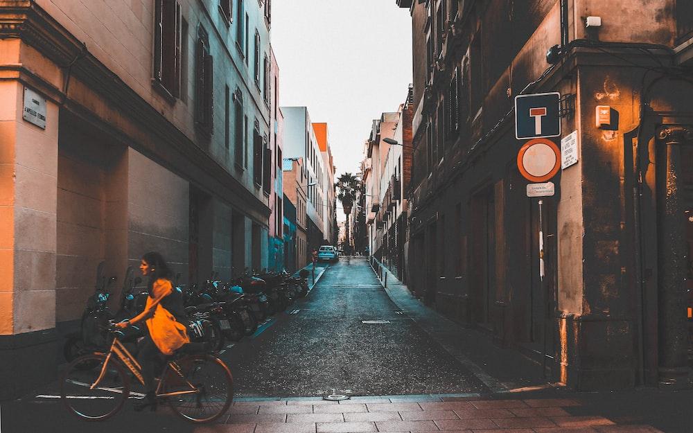 man riding bike near building