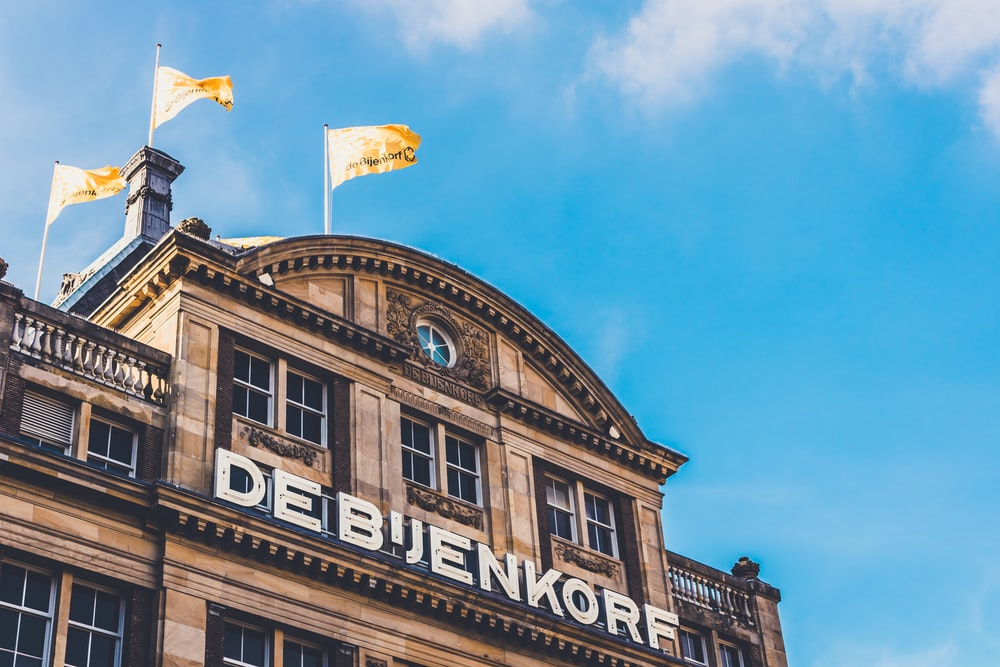 low angle photography of Deb'Jenkorf building