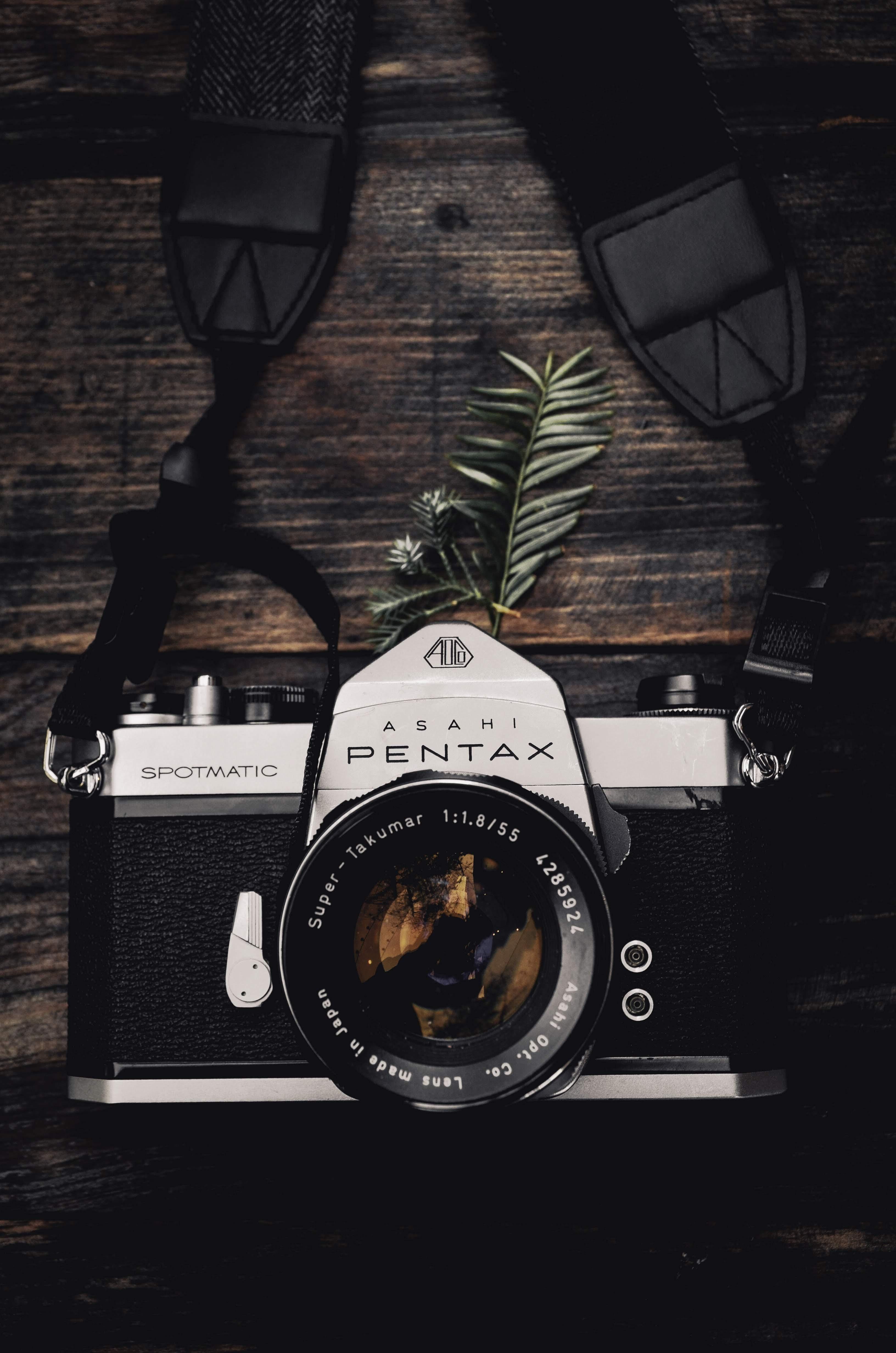 black and gray Pentax single-lens reflex camera