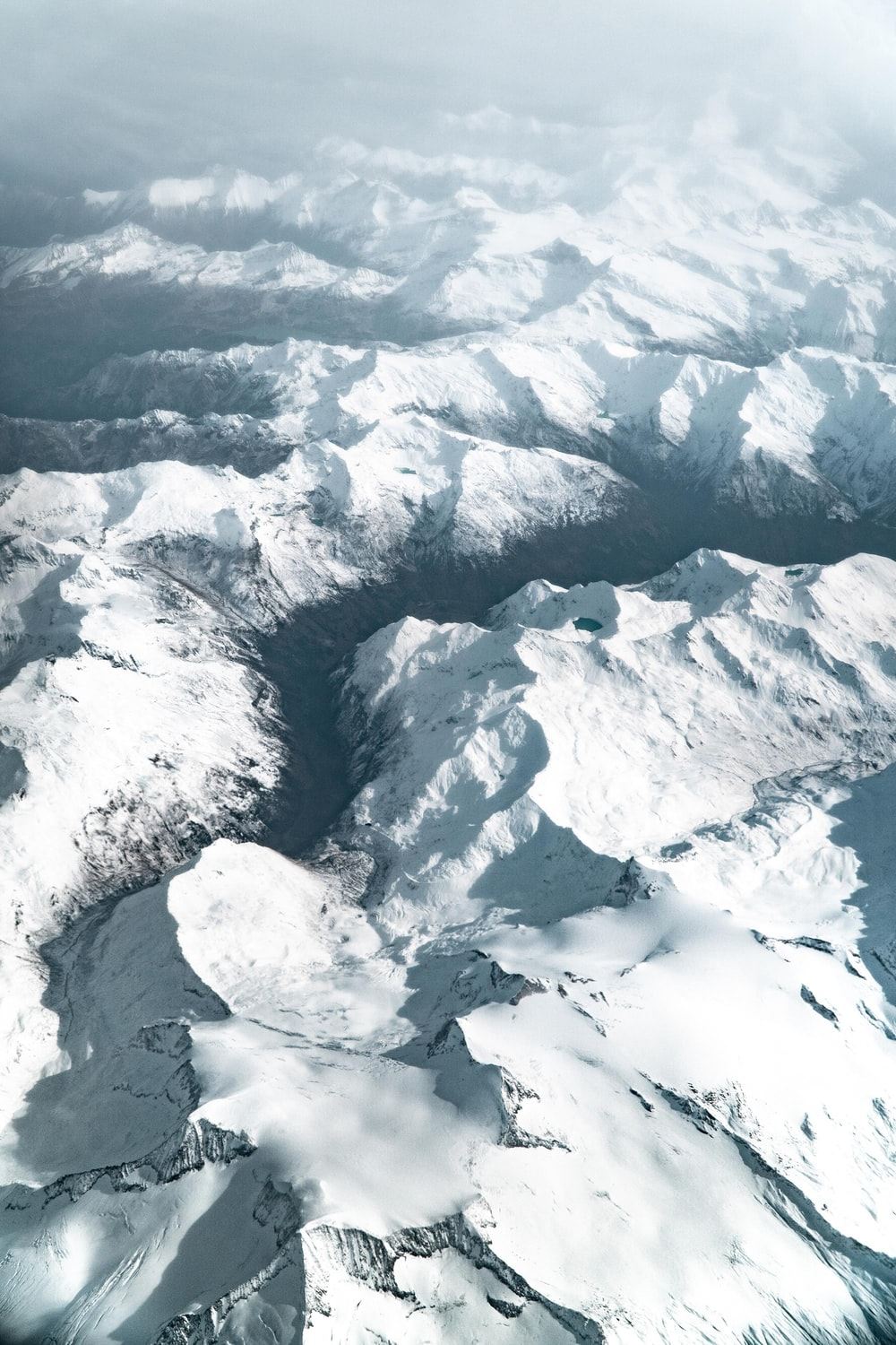 aerial photography of snow covered mountains during daytime