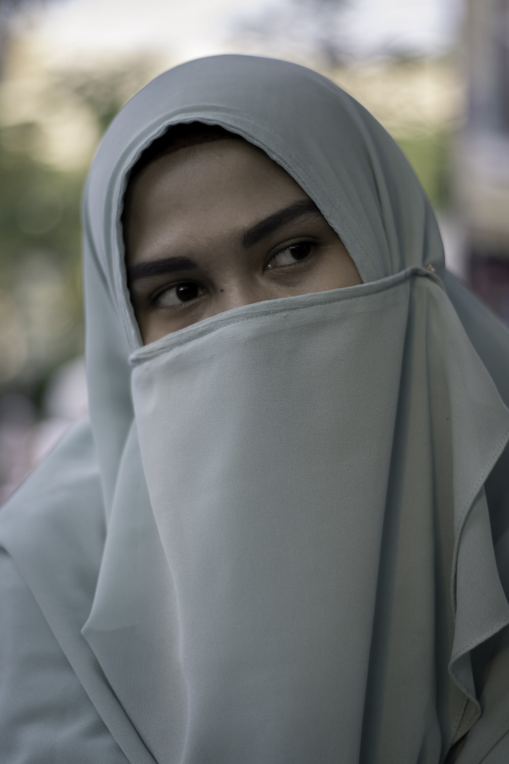 woman wearing blue hijab scarf