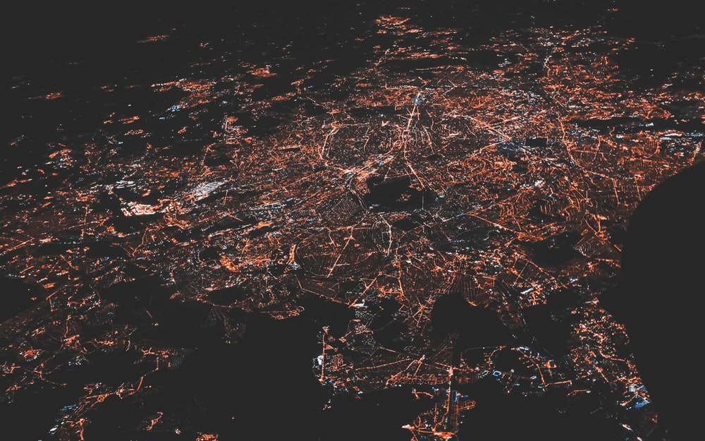 lighted city at night aerial photo