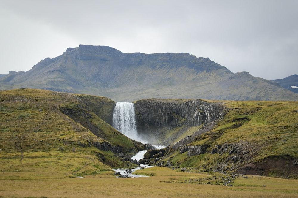 waterfalls in foot of hills