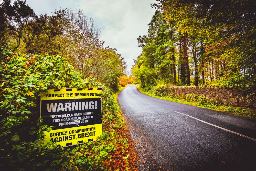 yellow and white warning road sign