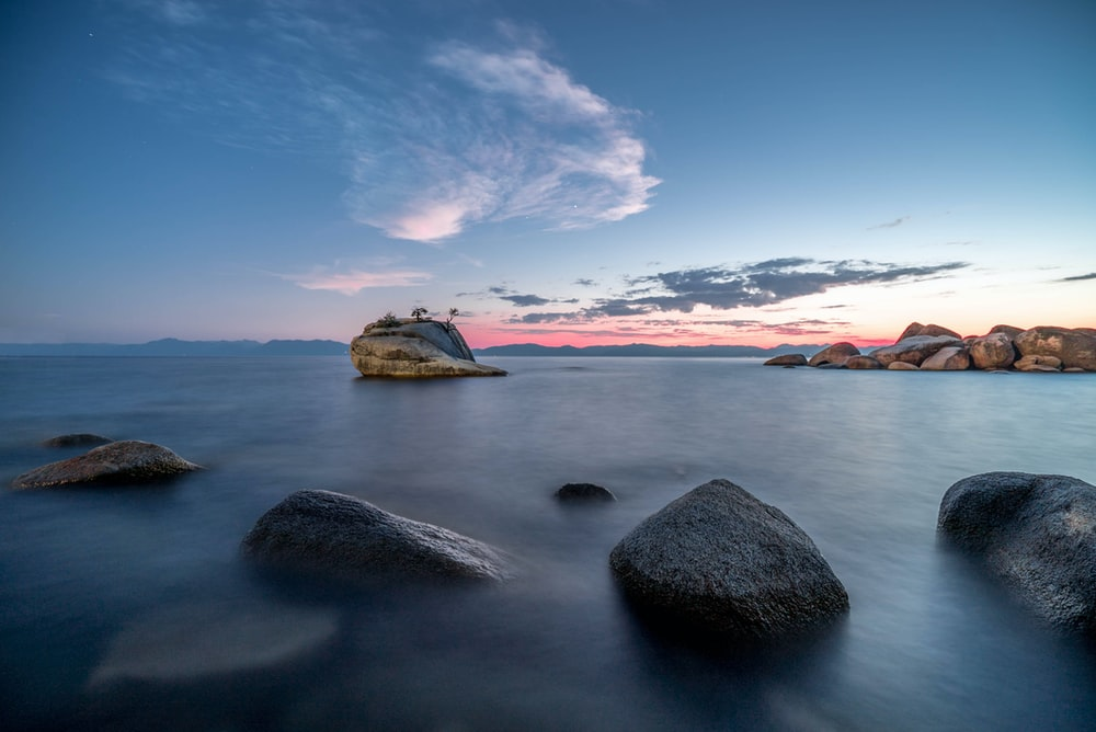 timelapse photography of stony beach during day time