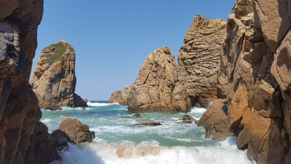 rocky mountain near the ocean