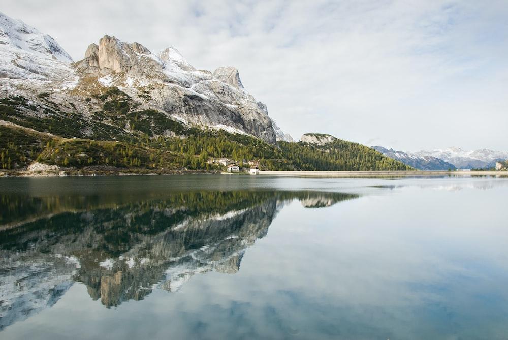 rock mountains near body of water