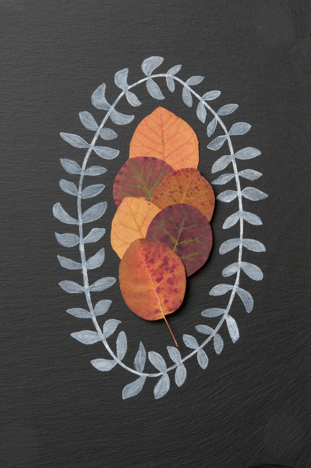 I created this still life with a hand drawn garland surrounding some autumn leaves with the idea that it could be downloaded and printed as a Christmas greeting card.