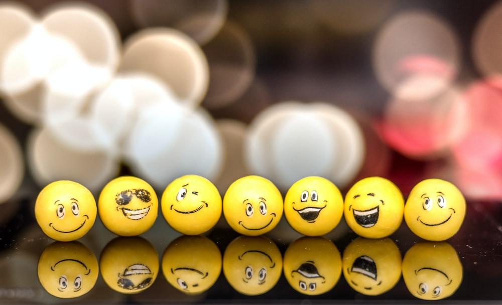 seven yellow emoji balls