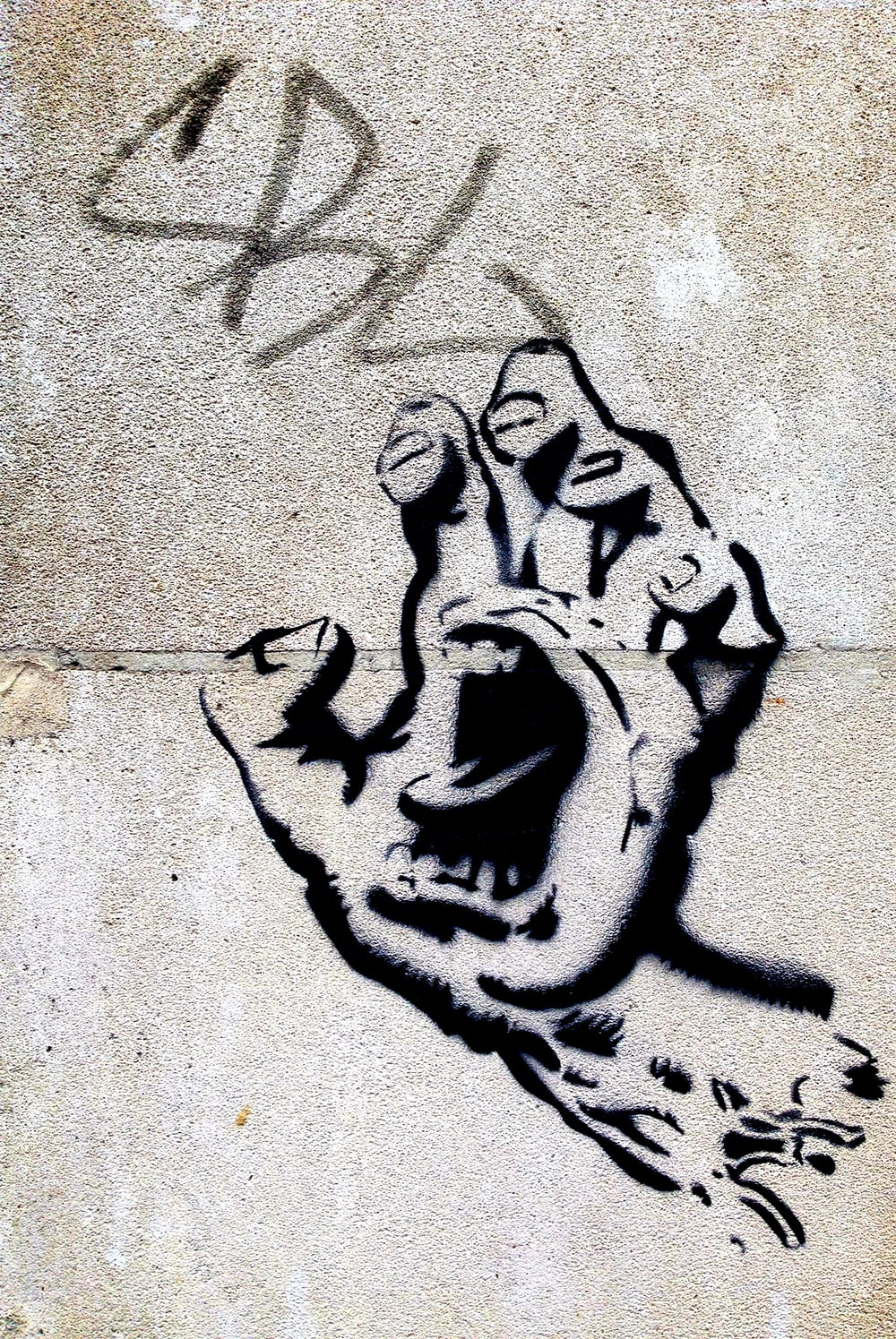 black hand with mouth wall art