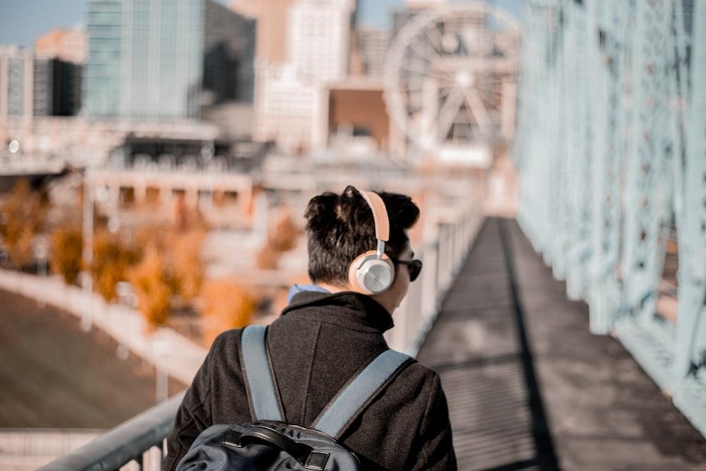 man wearing brown cordless headphones
