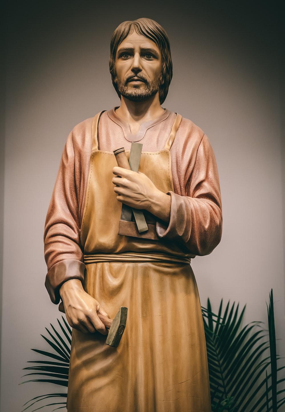 man holding hammer statue