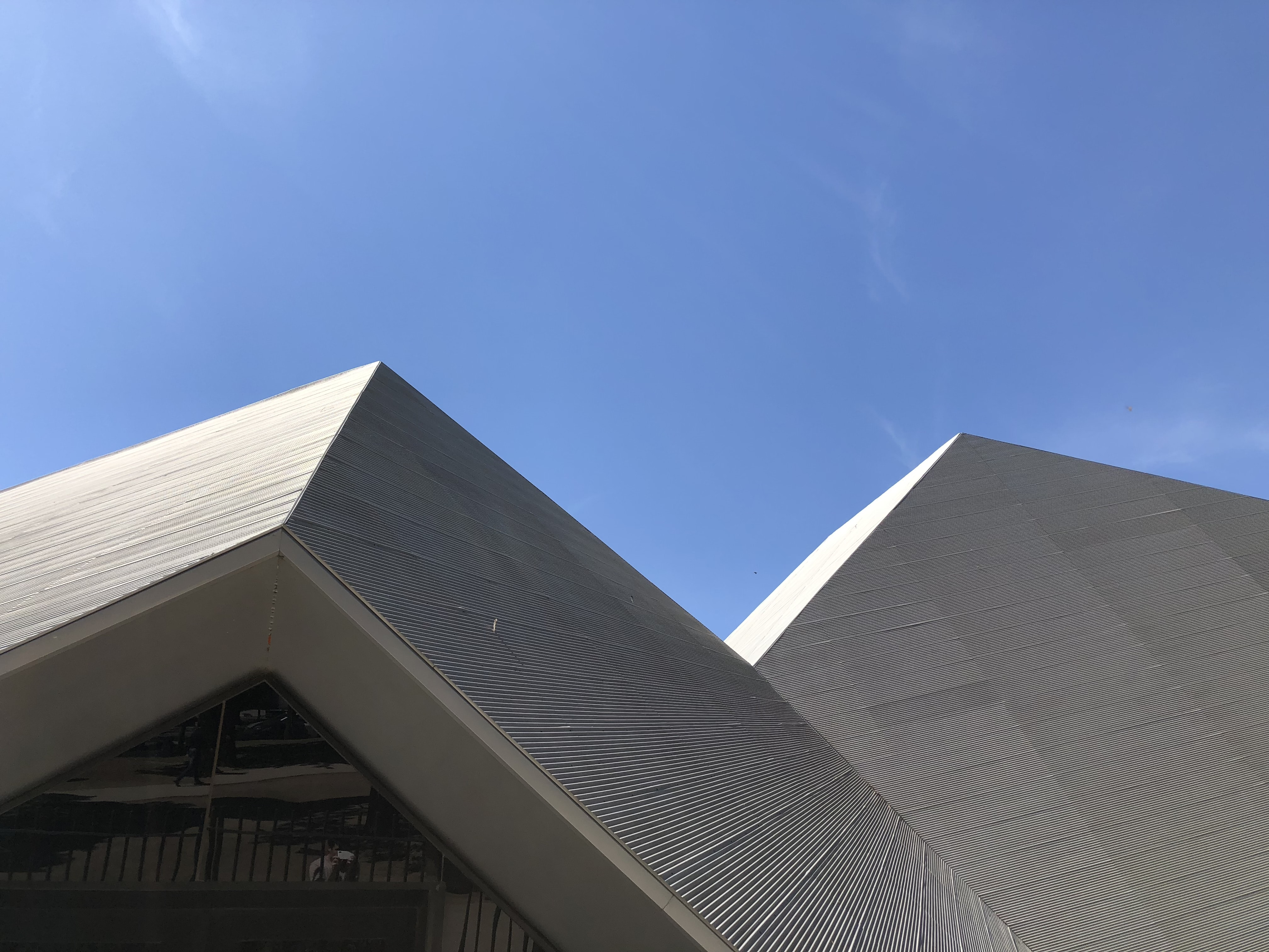 low angle photography of white building structure