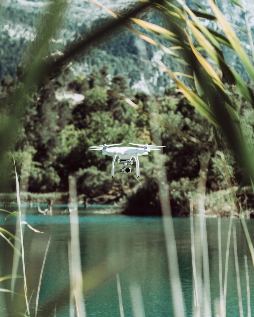 DJI Phantom 4 drone flying near body of water