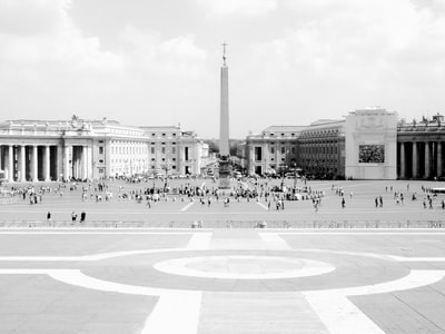 grayscale photography of people standing on field vatican city teams background