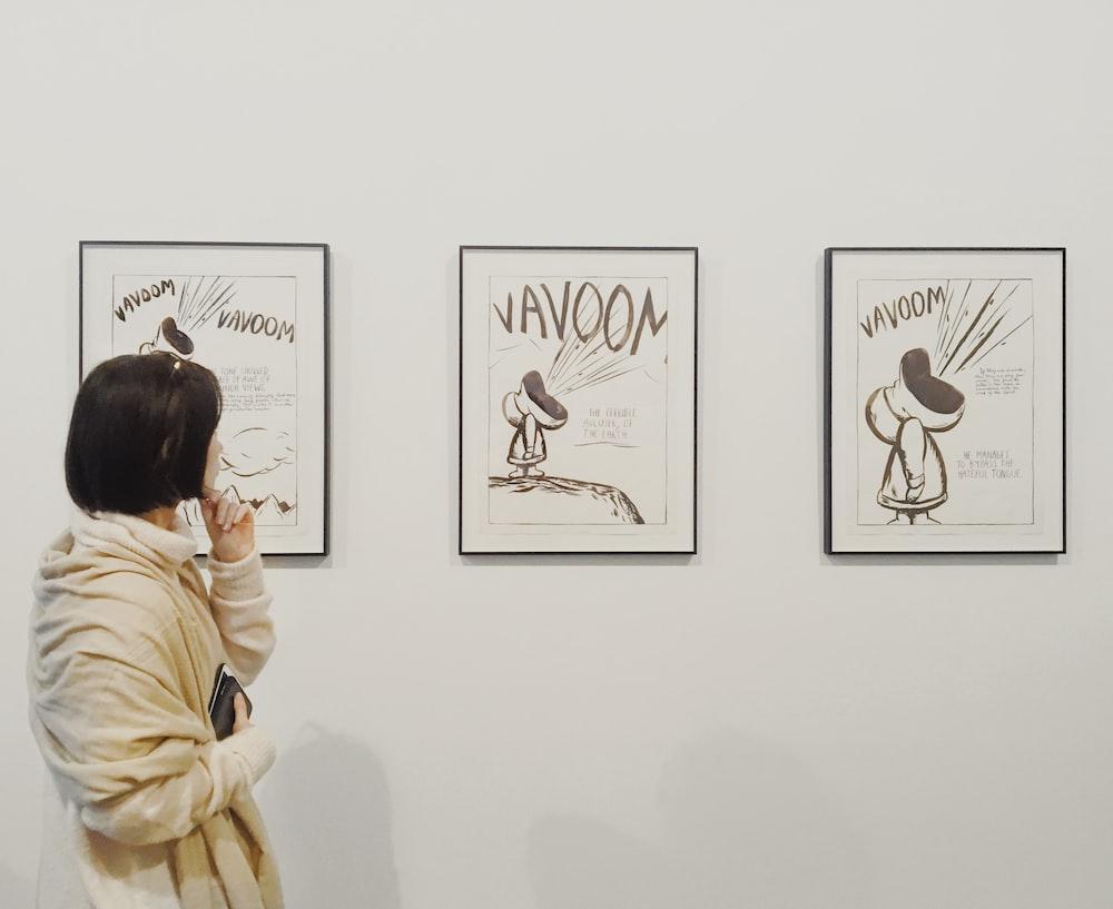 woman looking on wall arts