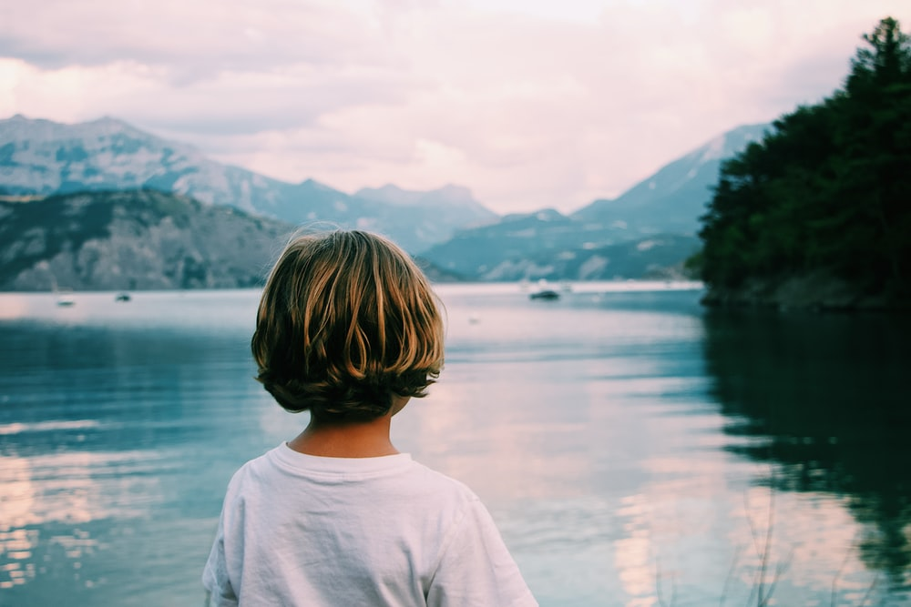 girl standing near the body of water