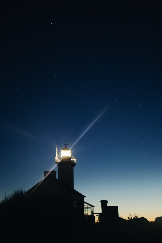 lighthouse shining at night