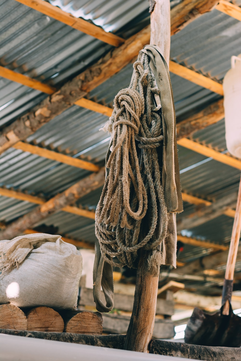 two hanged ropes in beige wooden pole