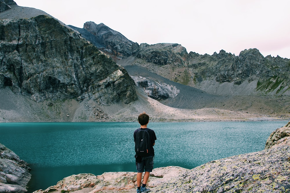 man standing in front of body of water