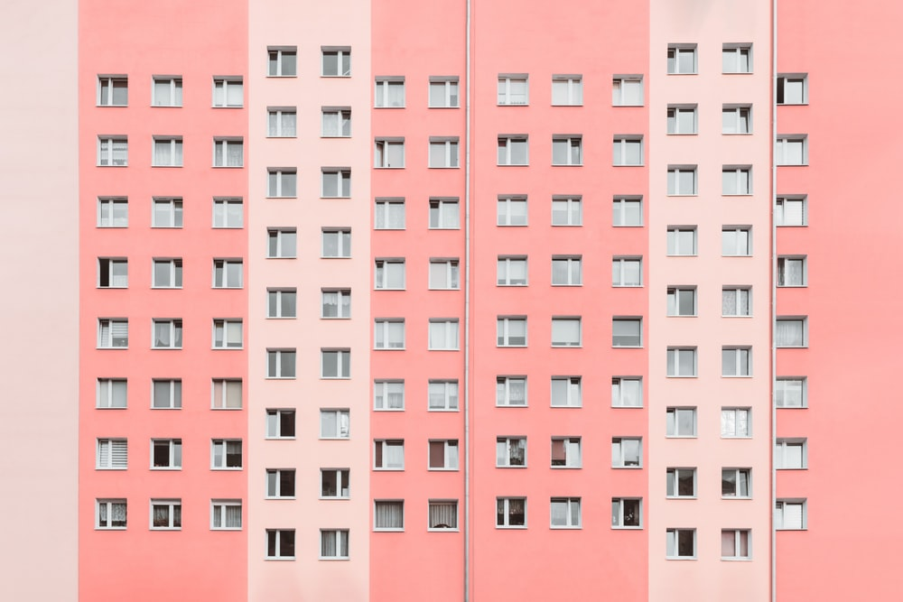 minimalist photography of pink high-rise building