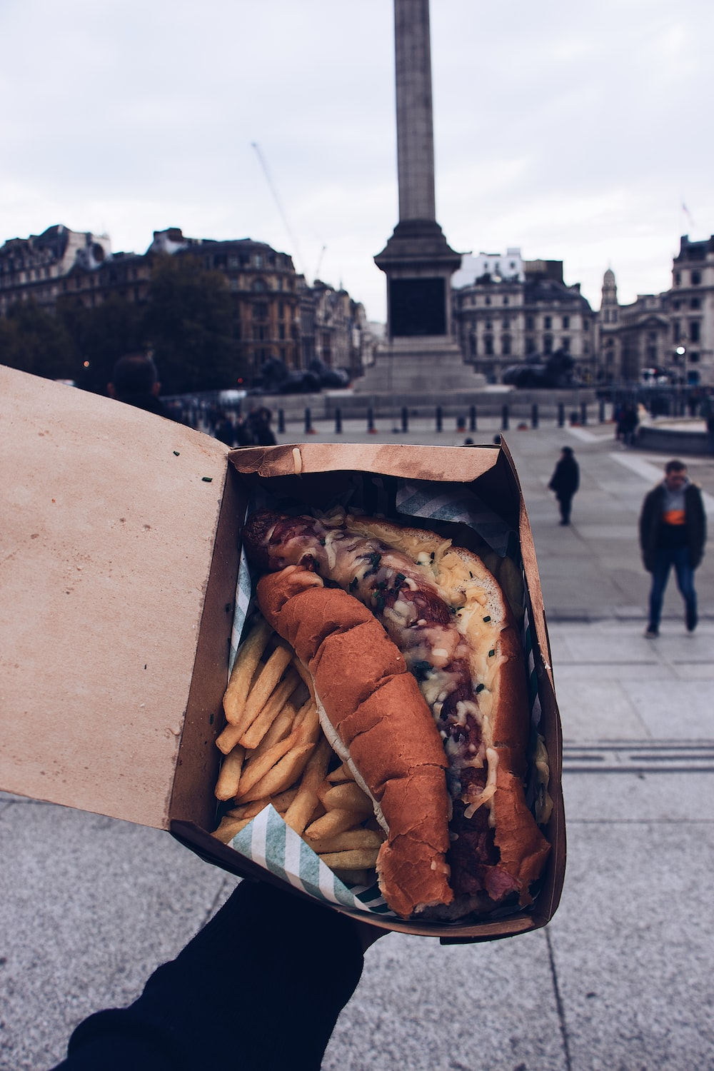 sausage with bun and fries