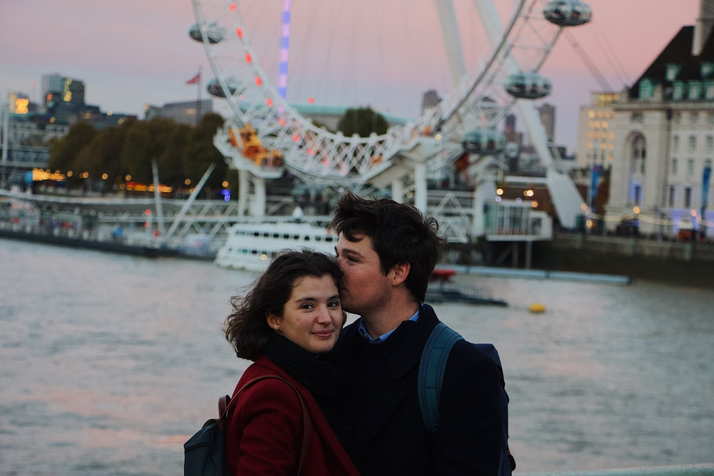 man and woman near London Eye