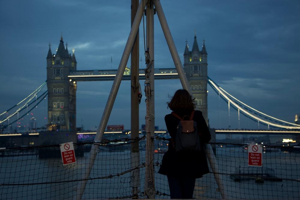 woman standing in front of Tower Bridge