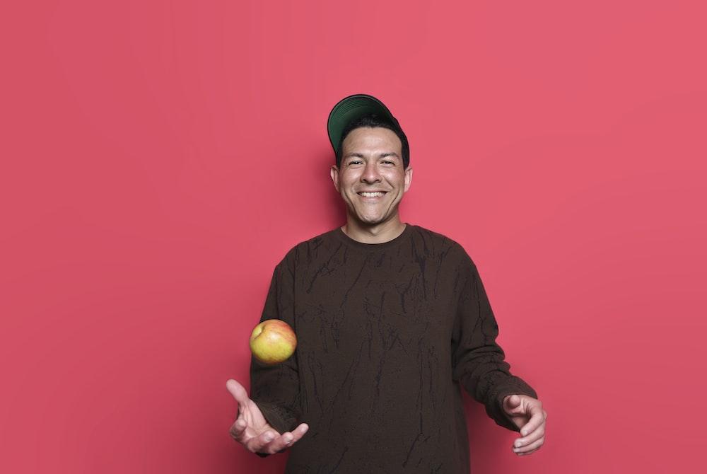 man throwing apple