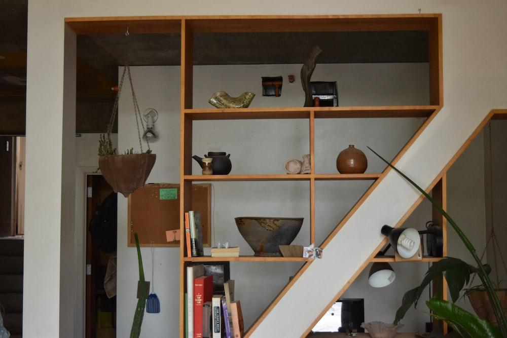 vases on brown wooden shelf