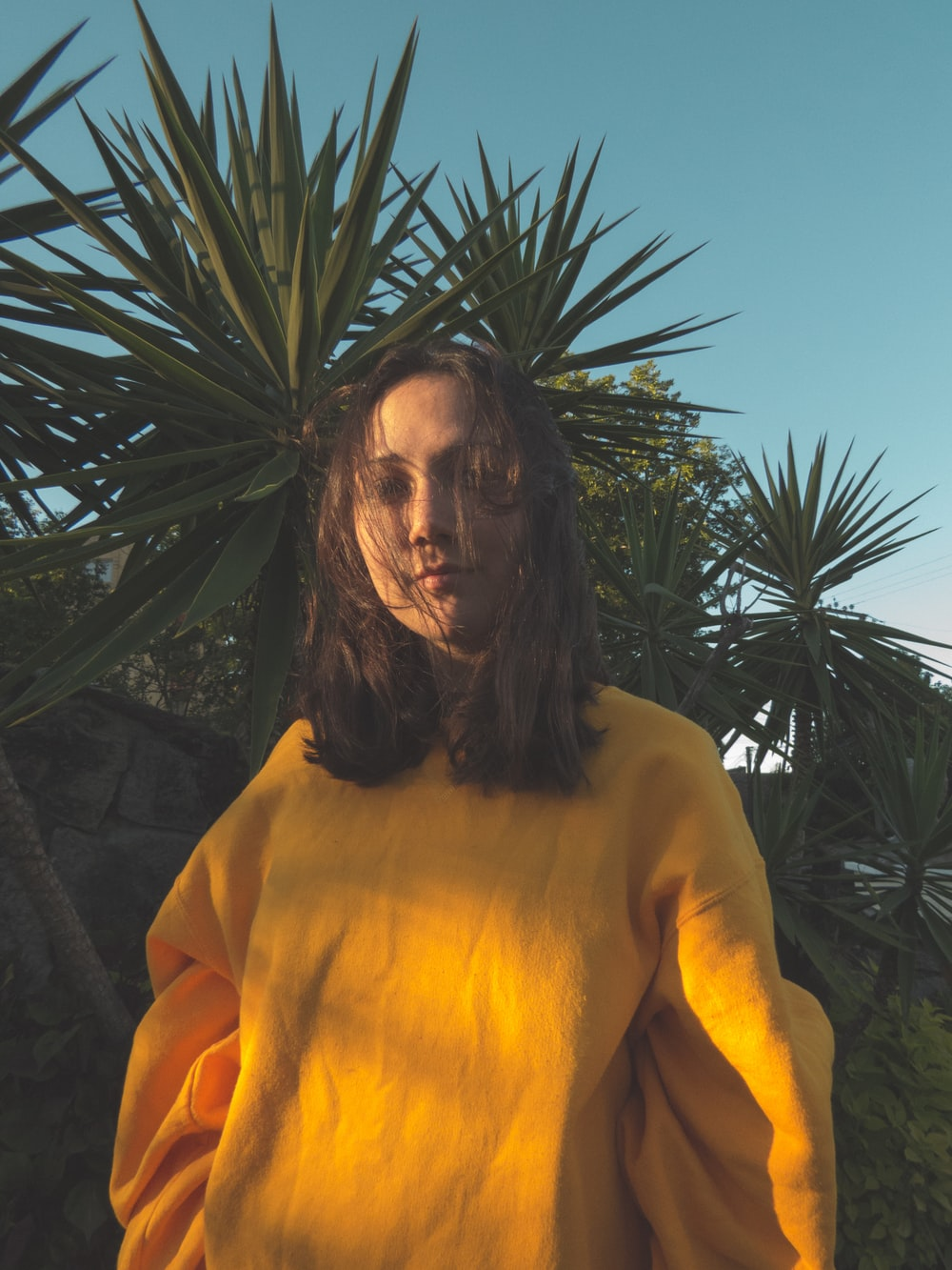 woman in yellow long-sleeved shirt