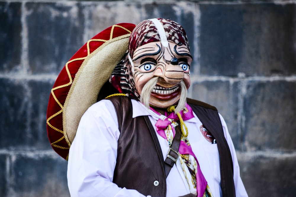 person wearing caricature mask and sombrero