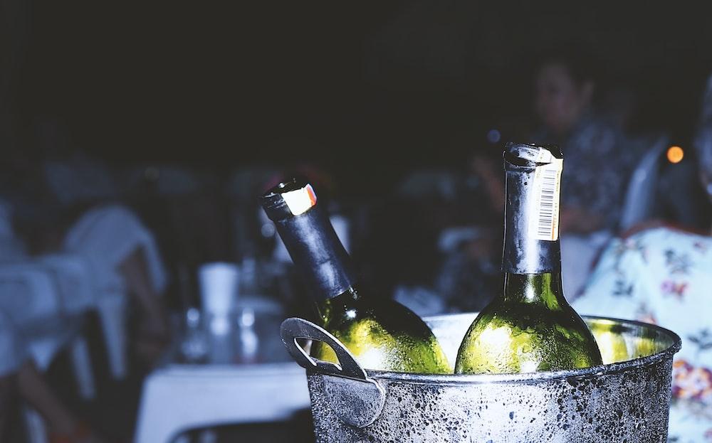 two liquor bottles in bucket