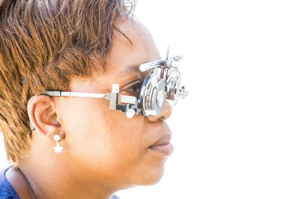 woman wearing glasses measuring device