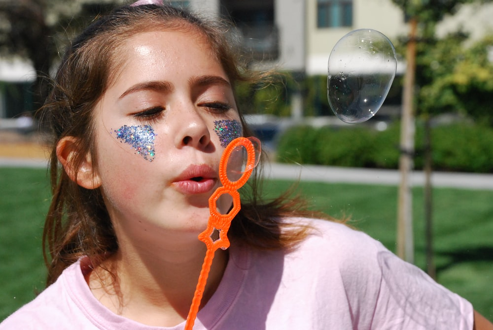 person blowing bubble