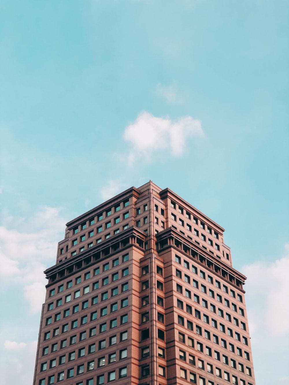 brown concrete building under blue sky