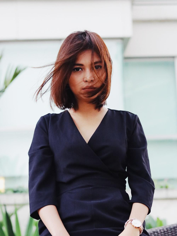 woman in black V neck long sleeved shirt