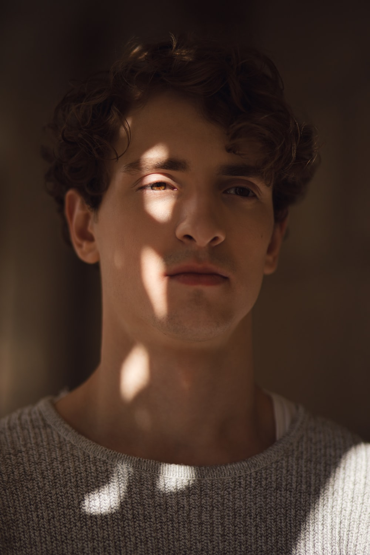 man wearing gray sweater