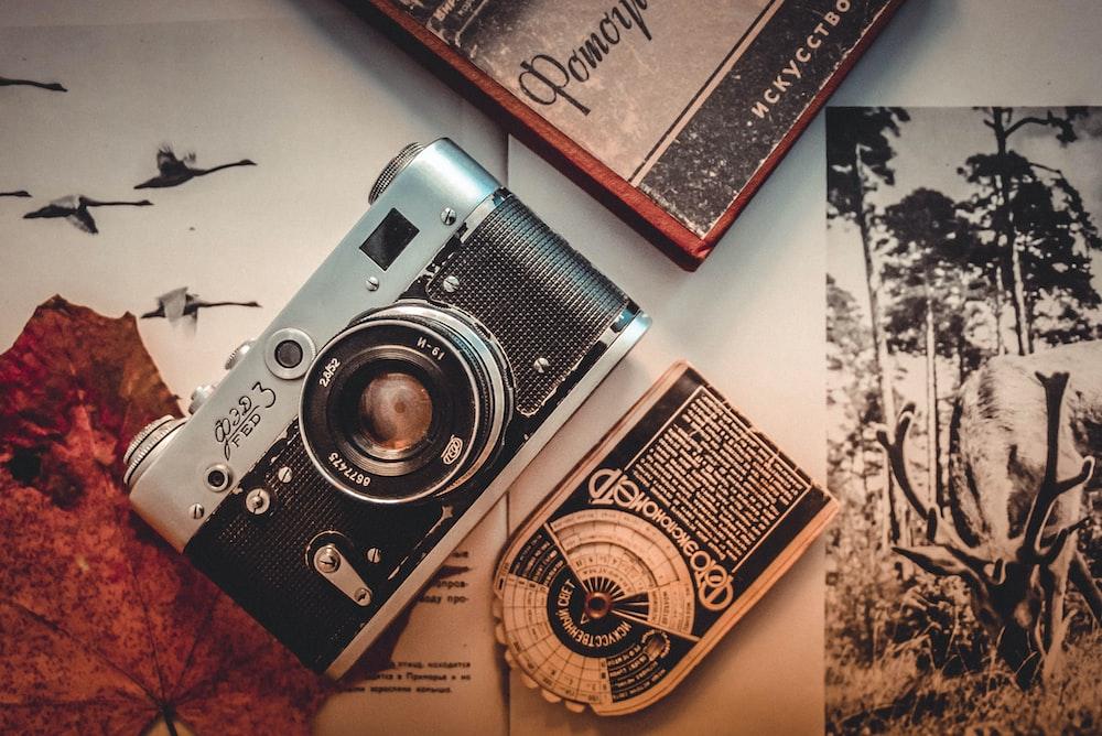 flat lay photography of mirrorless camera