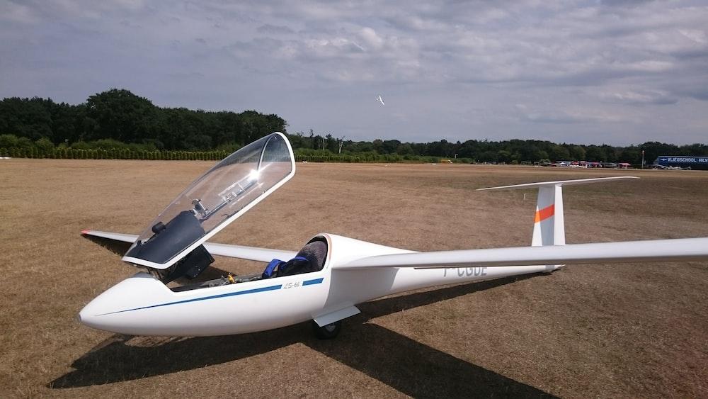 white plane on ground