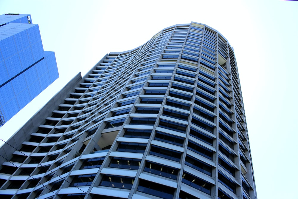 low angle photography of grey high rise building