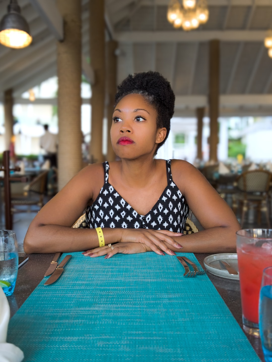This open air seafood restaurant in Ochos Rios Jamaica provided perfectly even lighting for this shot. We had one whole side of the restaurant to ourselves which really helped clear the scene. I was hoping to capture both her impatience and serenity.