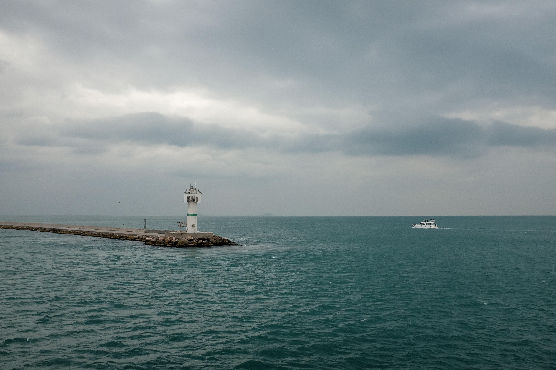 boat near lighthouse
