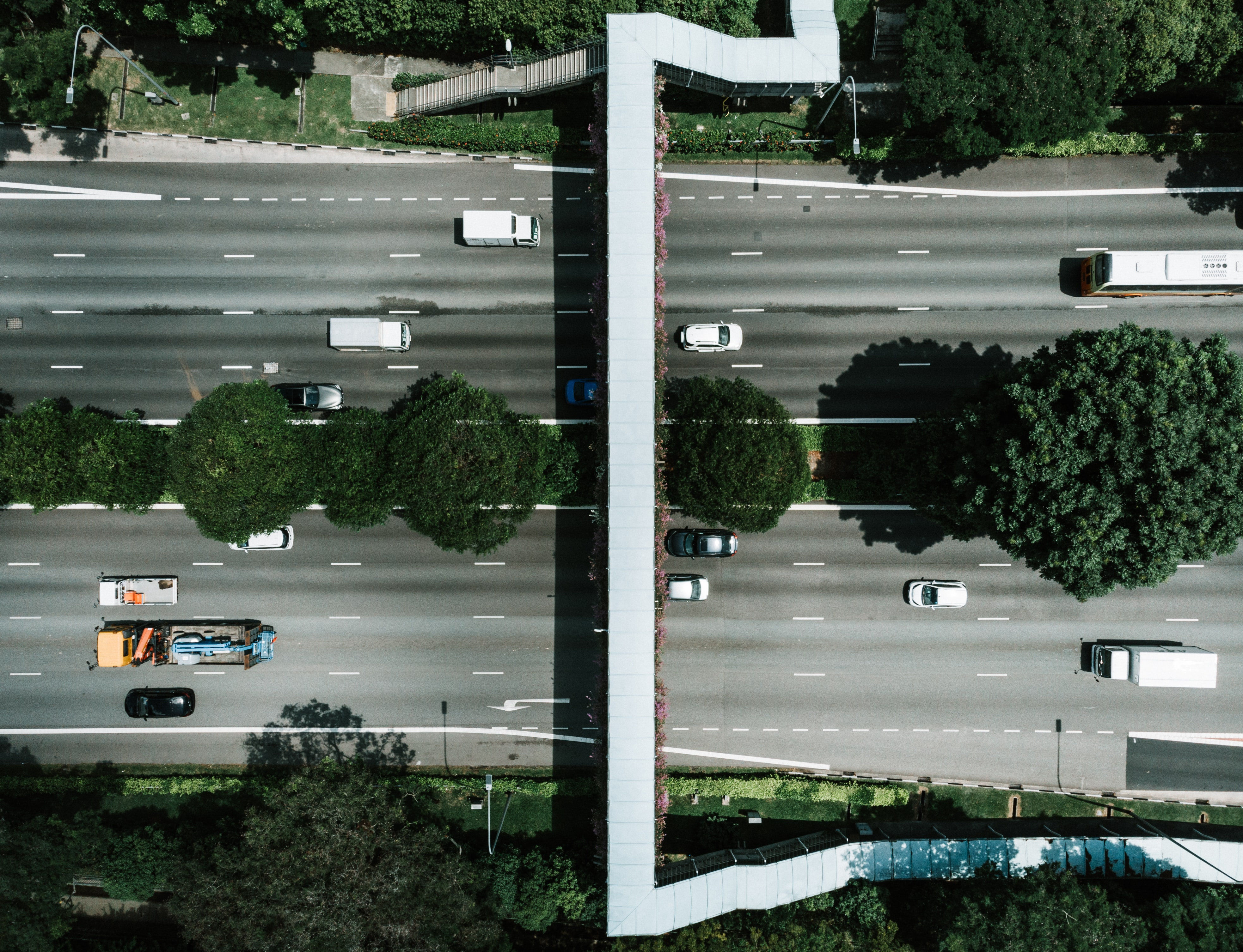 aerial photography of vehicle traveling on road during daytime