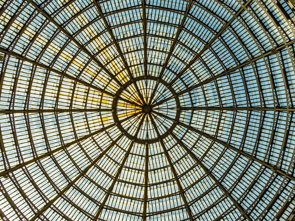 brown metal framed glass dome ceiling
