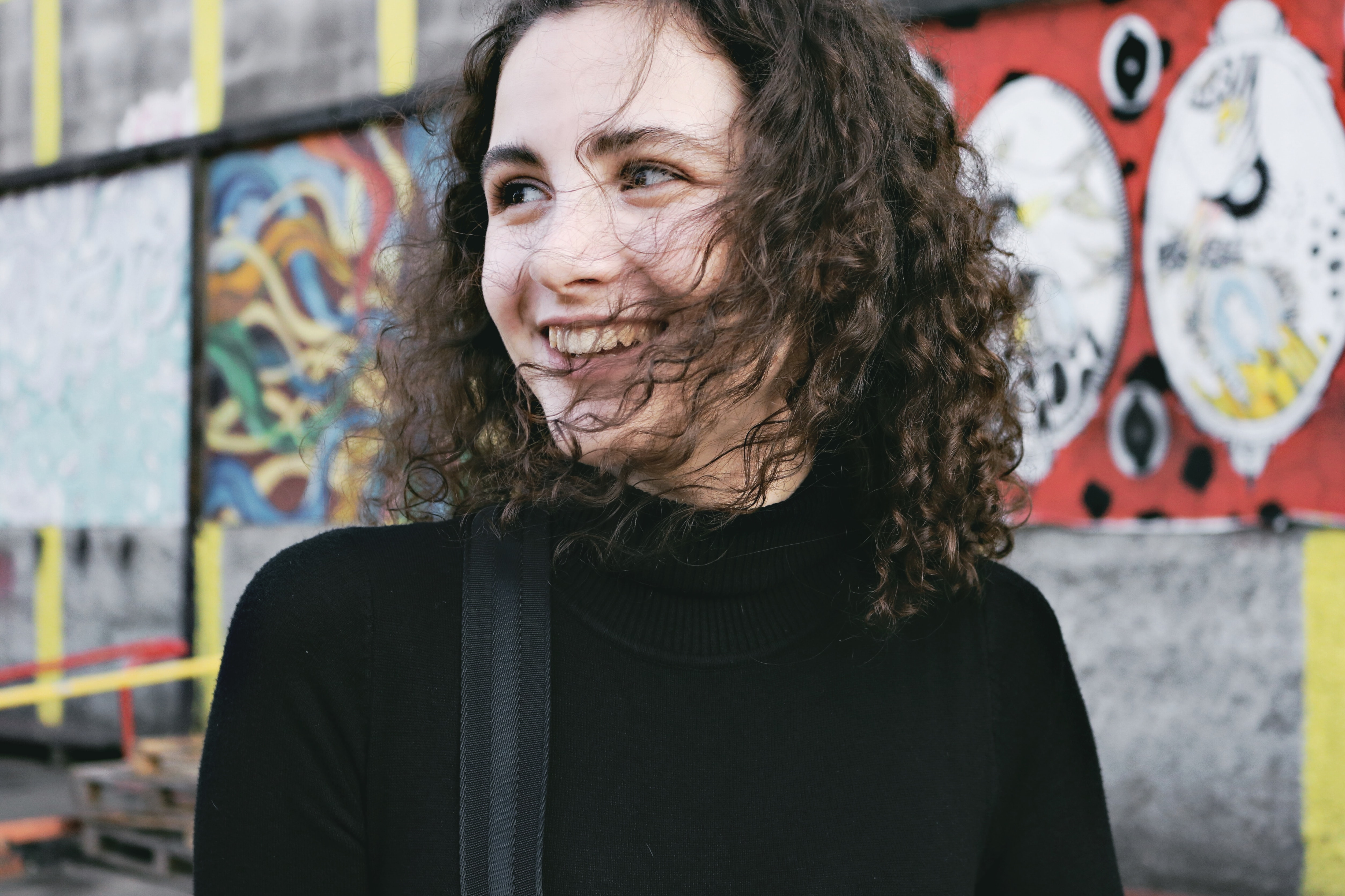 woman wearing black cowl-neck shirt