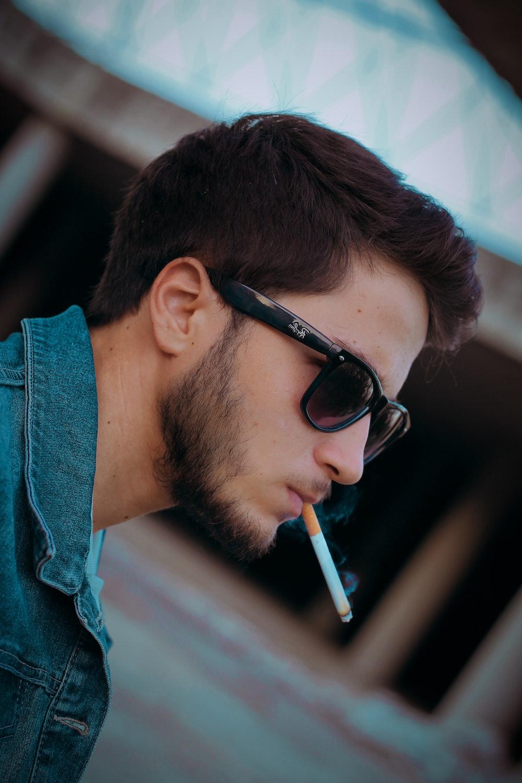 selective focus photography of man smoking