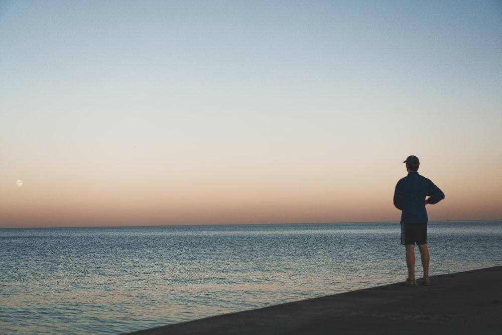 man standing near sea