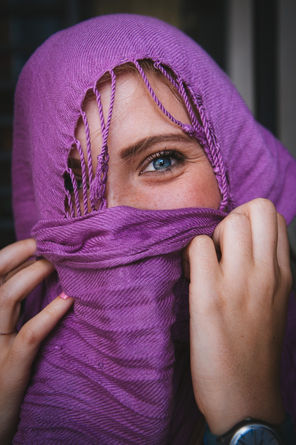 woman wearing brown hijab covering her face