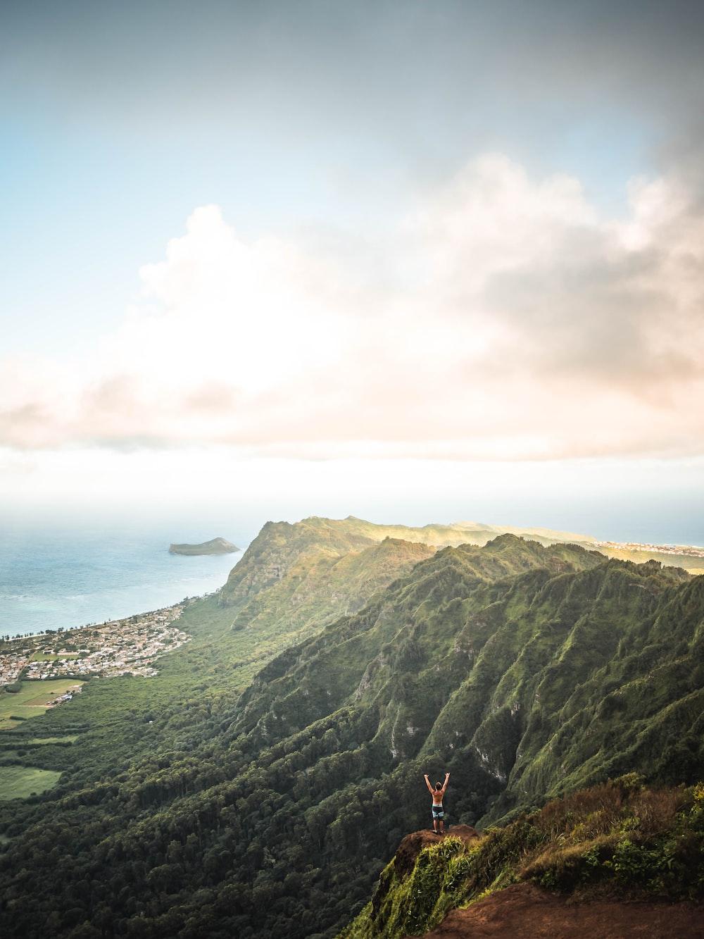 aerial view of mountain near ocean